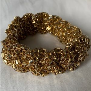 Gold tone braided bracelet - excellent condition